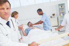 Doctors give oxygen to the patient - stock photo