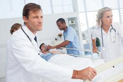Stock Photo of Doctors pushing the bed of a patient