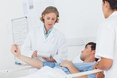 Stock Photo of Doctor taking the blood pressure of male patient
