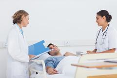 Stock Photo of Doctors explaining the symptoms to a patient