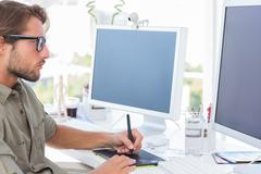 Stock Photo of Graphic designer using graphics tablet