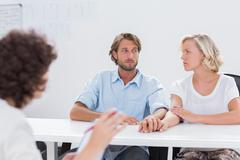 Stock Photo of Couple looking doubtful during therapy session