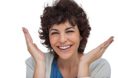 Stock Photo of Smiling woman being surprised