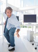 Employee skating through his office Stock Photos