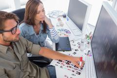 Photo editors choosing thumbnails for final cut Stock Photos
