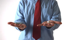 Man throwing a bolt and a screw in each hand Stock Footage