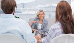 Psychologist speaking to a couple Stock Photos