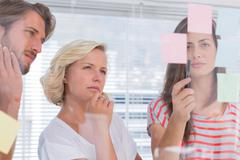 Colleagues looking doubtful - stock photo