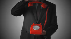 Man dropping down red phone receiver on dial phone Stock Footage
