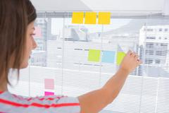 Woman pasting sticky note Stock Photos
