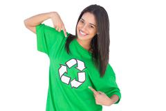 Stock Photo of Enivromental activist pointing to the symbol on her tshirt
