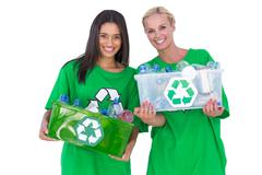 Enivromental activists holding box of recyclables Stock Photos