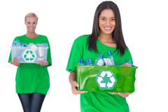 Two enivromental activists holding box of recyclables Stock Photos