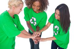 Three enviromental activists putting their hands together - stock photo