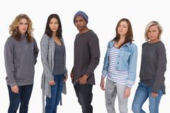 Fashionable young people in a line - stock photo
