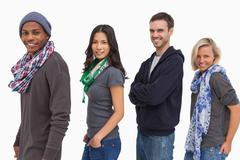 Stylish young people in a row smiling Stock Photos