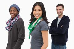 Stock Photo of Happy stylish young people in a row