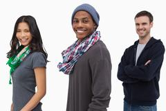 Smiling stylish young people in a row - stock photo