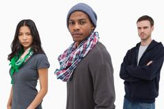Stock Photo of Unsmiling stylish young people in a row