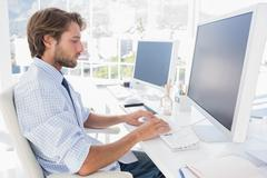 Designer sitting at his desk and working - stock photo