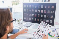 Stock Photo of Photo editor working on the contact sheet