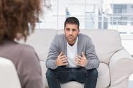 Stock Photo of Man telling therapist his problems