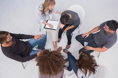 Stock Photo of Overhead of group therapy session