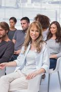 Woman smiling at camera in group therapy Stock Photos