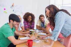 Editor picking photographs in a meeting - stock photo