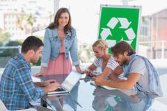 Team having meeting about eco policy - stock photo