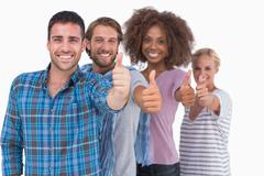 Happy stylish group giving thumbs up - stock photo