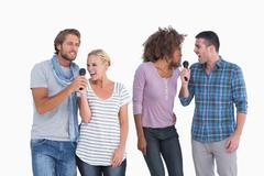 Fun group at karaoke - stock photo