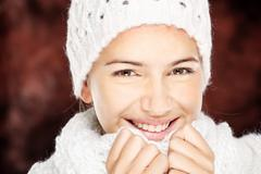 woman in wool sweater and cap - stock photo