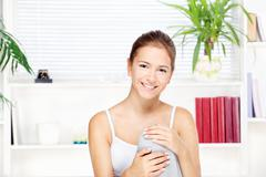 Young woman at home sitting on the sofa Stock Photos