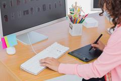 Editor using graphics tablet - stock photo