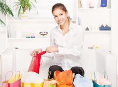 woman on couch with shopping bags - stock photo