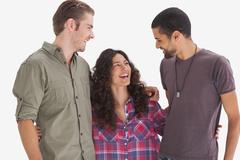 Stock Photo of Hipster friends smiling at each other