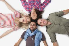 Stock Photo of Overhead of friends lying in a circle