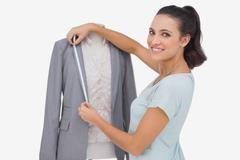 Fashion designer measuring blazer lapel Stock Photos