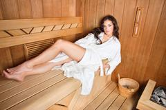 woman in sauna - stock photo
