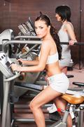 women exercise in gym center - stock photo