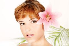 Woman with flower in hair Stock Photos