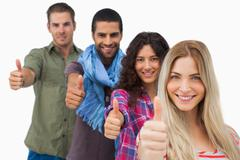 Friends giving thumbs up in a row Stock Photos