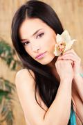 Woman holding white orchid Stock Photos