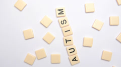 Autism spelled out in letter pieces Stock Footage