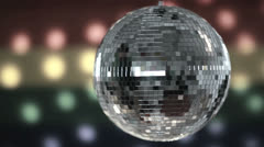 Disco ball spinning against gay pride flag Stock Footage