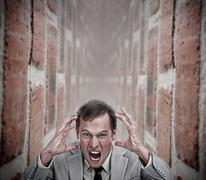 Angry businessman in a dead end Stock Photos