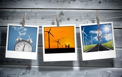 Three pictures of different themes hung with clothespins - stock photo