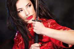 woman and katana/sword - stock photo