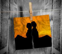 Torn photo of couple hung with a peg on a line Stock Photos